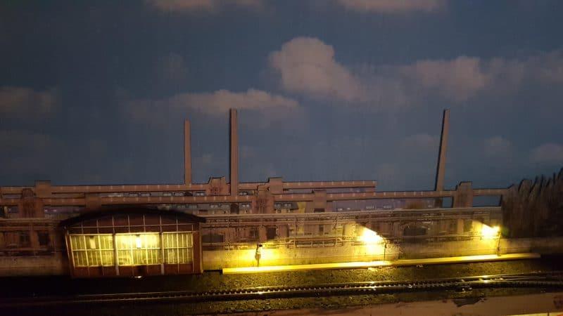 Hintergrund mit Halbgebäuden und Licht in 1:220